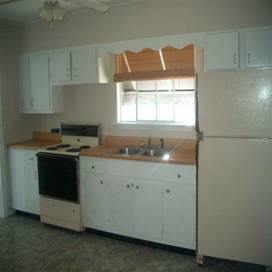 Kitchen with a refrigerator and a stove at 403 Walnut Street